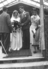 Sid and Eunice Bewsey outside the old church but inside the new building.