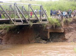 Photo showing erosion below bridge supports.